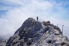 Lonely hiker on a mountain ridge Royalty Free Stock Photos