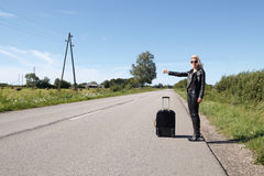 Lonely hitchhiker Stock Image
