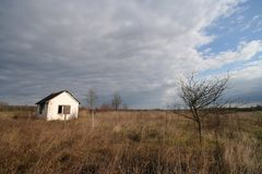 Lonely house. With stormy clouds Royalty Free Stock Photo