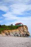 Lonely house. A lonely house on a cliff near the sea Stock Photography