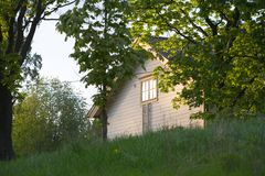 Lonely House. Lonely wooden house surrounded by a wild garden Royalty Free Stock Photography
