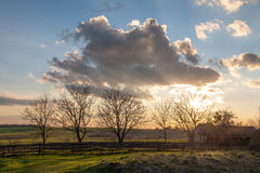 Lonely house. Beautiful sunset over the rural house Royalty Free Stock Images