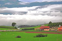 Lonely house in clouds. Trentino Alto, Italy Royalty Free Stock Photos