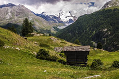Lonely house in european alps in Switzerland Royalty Free Stock Image