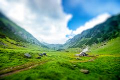 Lonely house on the mountains Stock Photography