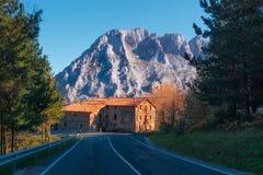 Lonely house near a road near Urkiola mountain. Range stock photo