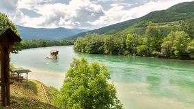 Lonely house on the river Drina in Bajina Basta. Cloudy sky and royalty free stock photography
