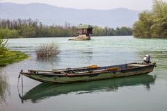 Lonely house and small boat on the river Drina royalty free stock images