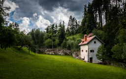 Lonely House under Dramatic Sky Stock Images