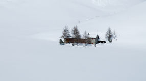 Lonely house in winter. House during winter time in Switzerland royalty free stock photos