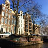 Lonely houseboat in Amsterdam. Beautiful houseboats on Amstel Royalty Free Stock Photo