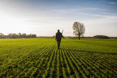 Lonely hunter. On the field Royalty Free Stock Image