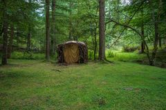 Alone wooden hut in a forest. Evergreen scene with some loneliness & calm feeling at the Basque Country in Spain. A lonely hut made of woods alone in a green royalty free stock image