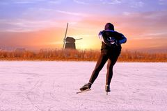 Lonely ice skater in the countryside from Netherlands at sun. Lonely ice skater in the countryside from the Netherlands at sunset Stock Image