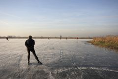 Lonely ice skater in the Netherlands Royalty Free Stock Photos