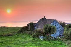 Lonely irish house at sunset in Doolin Stock Photography