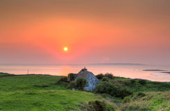Lonely irish house at sunset in Doolin Stock Image