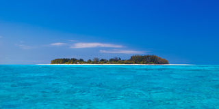 Lonely island. In crystal clear water Royalty Free Stock Photography