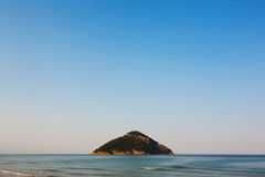 Lonely island at horizon Stock Photos