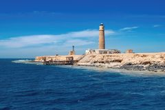 Lonely island with lighthouse, Big Brother Island, Red Sea Egypt. Lonely island with an old lighthouse, Big Brother Island, Red Sea Egypt royalty free stock photo