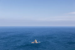 Lonely island in the middle of the ocean. Dangerous rocky lonely island in the middle of the ocean royalty free stock image