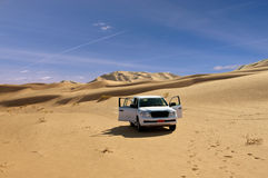 Lonely jeep in the desert. A lonely jeep in the Rub Al Khali Desert (Oman royalty free stock image