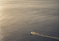 Lonely jet ski. A jet ski sailing alone in the open sea Royalty Free Stock Photos