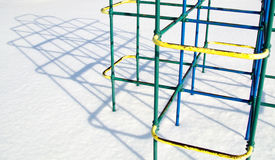 Lonely Jungle Gym in Winter. Unused jungle gym with interesting shadow on very cold winter day Stock Photography