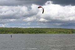 Lonely kitesurfer on the lake stock images