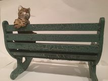 Lonely Kitty. Cat sitting on a bench, waiting for its rightful owner Stock Photos