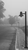 The lonely lamp. The lonely lamp on the walkway of nowhere Stock Image