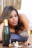 Lonely Latin girl with champagne Royalty Free Stock Photography