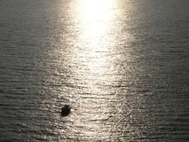 so lonely in life and ocean. Sunlight on water. royalty free stock photo