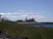 Lonely light house. The abandoned light house sits in the bay near Bridgeport stock photos
