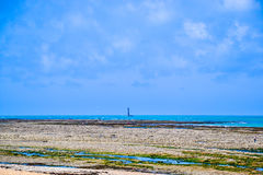 Lonely lighthouse at low tide in France during summer. Taken in morbihan in france Royalty Free Stock Photos