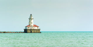 Lonely Lighthouse in the sea Stock Photos