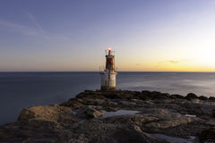 Lonely lighthouse at sunrise Royalty Free Stock Photo