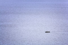 Lonely little boat in the sea Royalty Free Stock Image