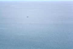 Lonely little boat in the sea Royalty Free Stock Images