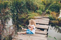 Lonely little child fishing Stock Images