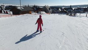 Lonely little girl on the ski. Little girl is learning how to ski Royalty Free Stock Photography