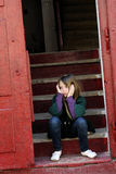 Lonely little girl standing on stairs Royalty Free Stock Image