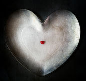 Lonely little heart background great. Lonely little heart on the background of the great Stock Photography