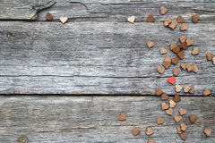 Lonely little red heart through the wooden heart Royalty Free Stock Photography