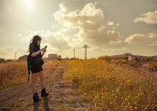 Lonely lost brunette watching her phone in the countryside royalty free stock image