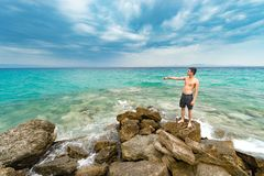 Lonely lost man standing in front of the pacific ocean stock photos