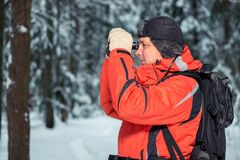 Lonely lost tourist man in winter forest. With binoculars Stock Images