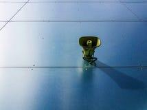 Loudspeaker on blue background. Lonely loudspeaker on blue metallic wall Royalty Free Stock Image