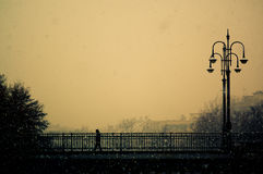 A lonely man. Walks on the bridge Royalty Free Stock Photography