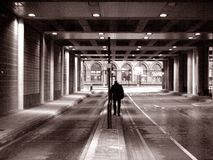 Lonely man. Under bridge in london Royalty Free Stock Photo